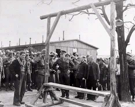 Captain Liethen and Gen. Eisenhower inspect camps note gallows