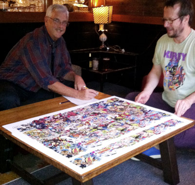 Tom Morehouse signing and numbering the new edition with help from Rand Hoppe. Photo by Chris Repella.